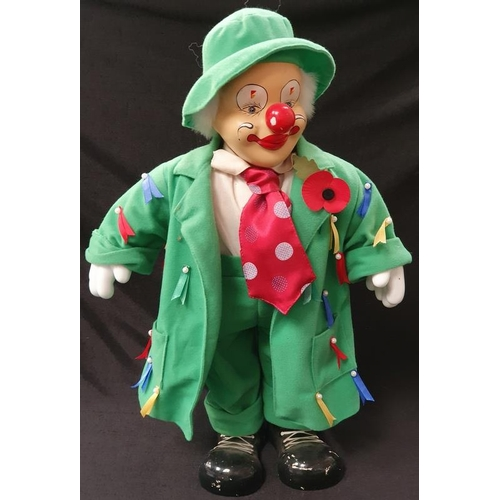 1001 - A modern clown figurine doll in green outfit....
