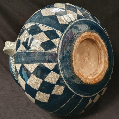 1002 - An antique blue and white glazed pottery twin handled jug....