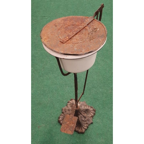1006 - A vintage floor standing ashtray on cast iron base....