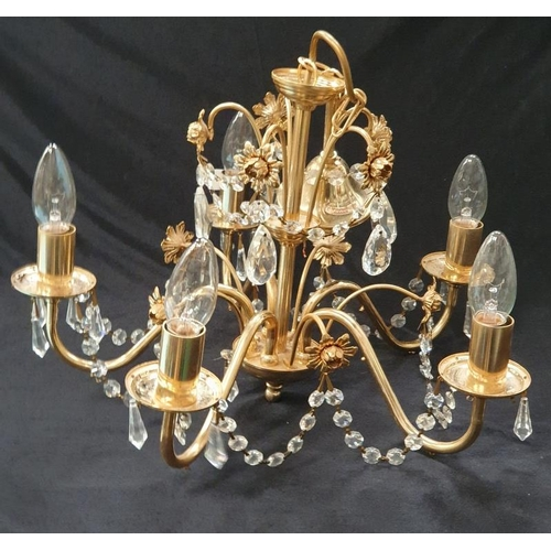 1010 - A modern brass chandelier....