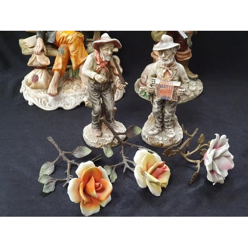 1017 - Four Capodimonte figurines with china flowers....