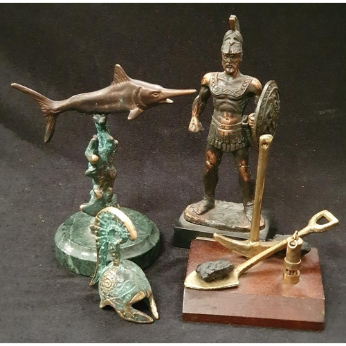 1030 - Four assorted brass ornaments....