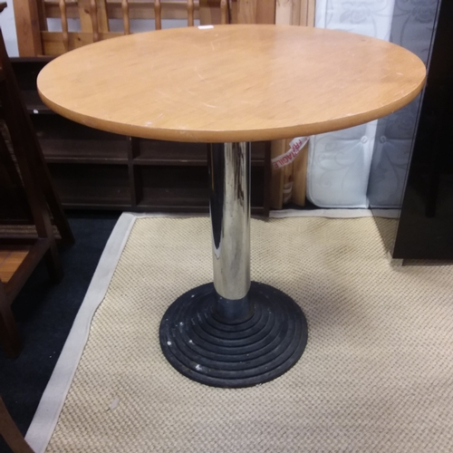 1128 - An iron based bistro table....