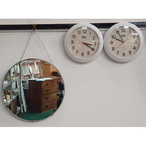 1048 - A vintage 1950's mirror together with two modern Coopers Radio Controlled wall clocks....