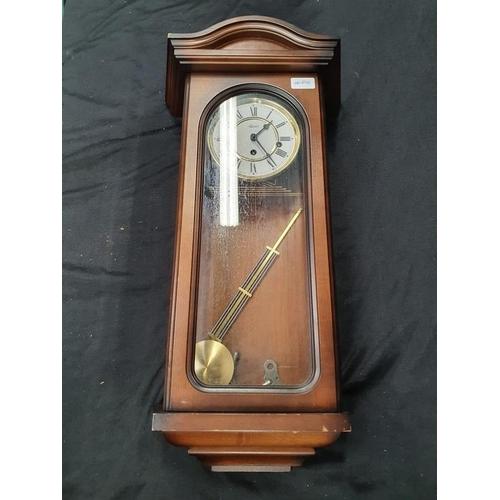 1105 - A modern mahogany wall clock....