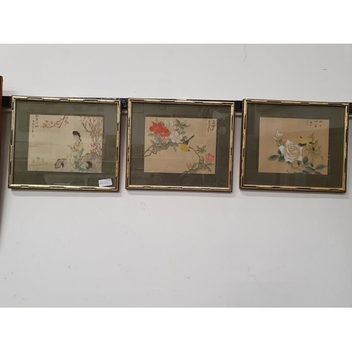 1115 - A set of three framed and glazed oriental pictures....
