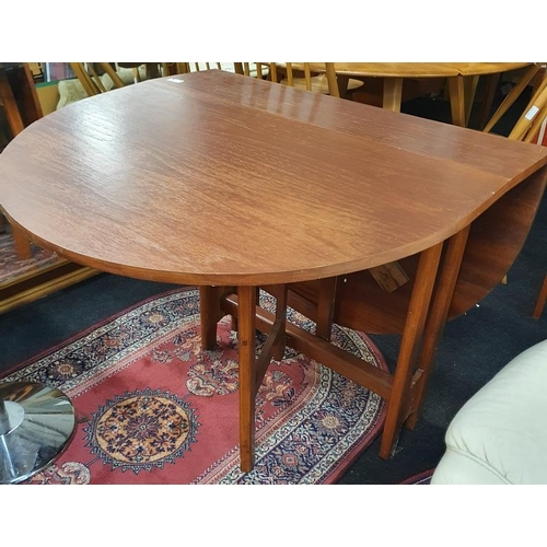 1131 - An oak stained as mahogany gate leg table....