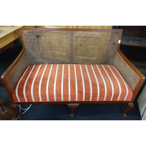 1133 - A vintage mahogany framed two seater settee with rattan back....