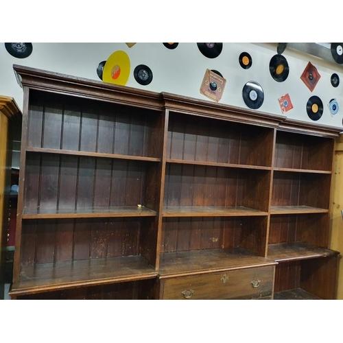 1136 - A large oak breakfront bookcase. H:201, W:236, D:39 (cm)....