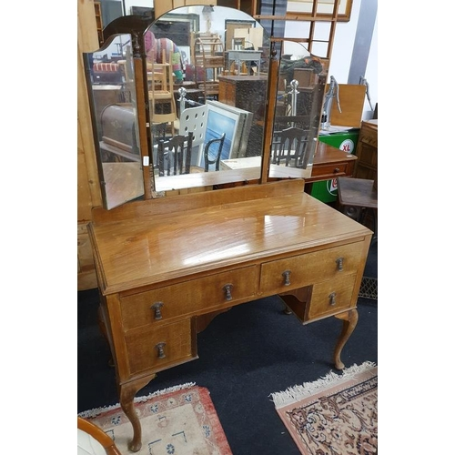1138 - A 1920's mahogany kneehole dressing table with tri fold mirror to top....
