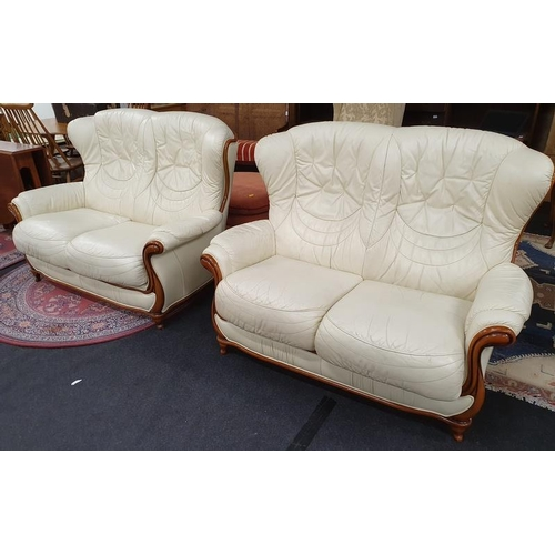 1142 - A pair of modern two seater settee's upholstered in cream leather....