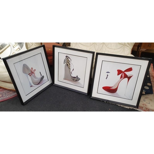 1144 - A set of three modern framed and glazed furnishing prints of high heeled shoes....
