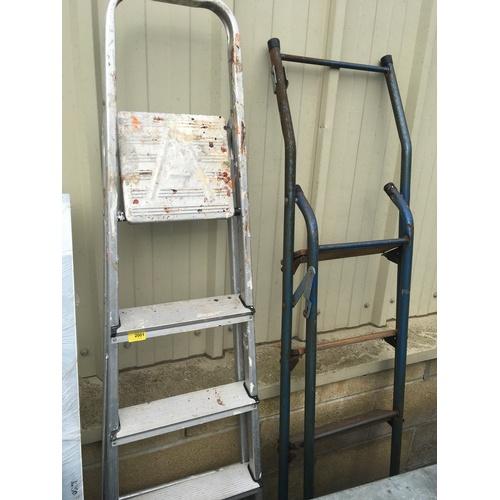 2001 - Two metal step ladders....