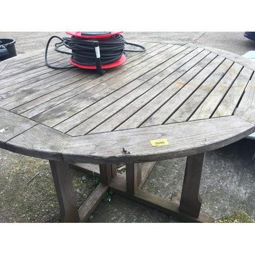 2048 - A round hardwood outdoor table....