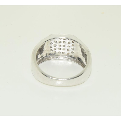 320 - A 9ct white gold mans diamond signet ring, approx 1ct, Size T....