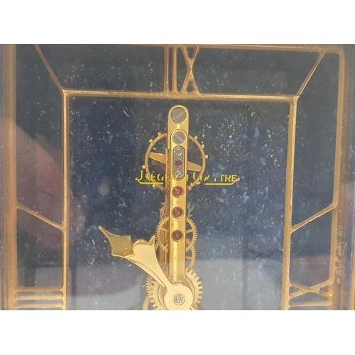 32 - A Jaeger Le Cultre clock (needs service)....