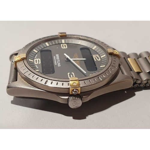 14 - Breitling Aerospace gents titanium and 18ct gold wristwatch. Working with box....