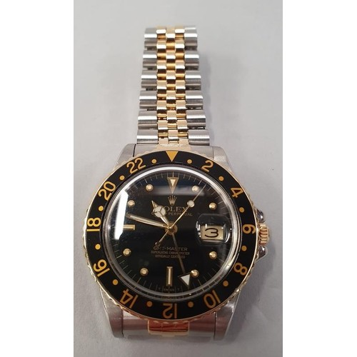 26 - Rolex GMT Master BI-Metal, box and papers, 1980....