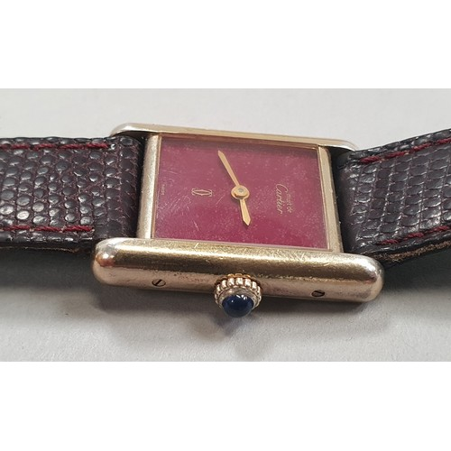 35A - Cartier De Must silver with gold plate wristwatch with certificates....