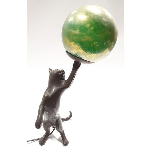 11 - A contemporary bronzed lamp in the form of a cat....