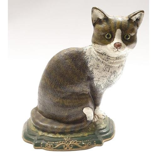 12 - Cast metal doorstop of a cat....