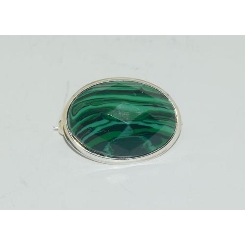 1372 - A silver malachite brooch....