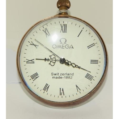 1204 - A brass and glass desk ball clock....