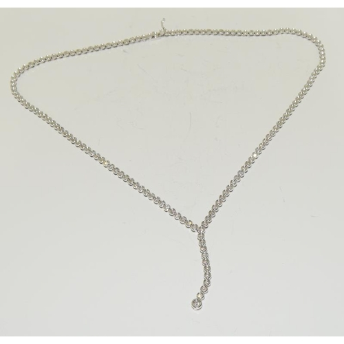 1379 - A good 18ct white gold diamond necklace the articulated line set with 31 round brilliant cut diamond...