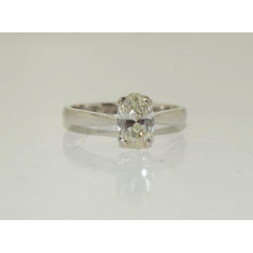 1395 - A fine 18ct white gold single stone oval cut diamond ring of 1.5ct approx. Size O....