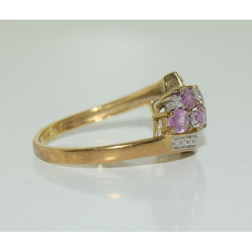 1355 - A 9ct gold diamond and pink tourmaline ring, Size Q....