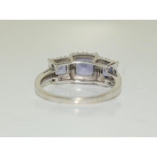 1370 - 9ct white gold tanzanite ring. Size O....