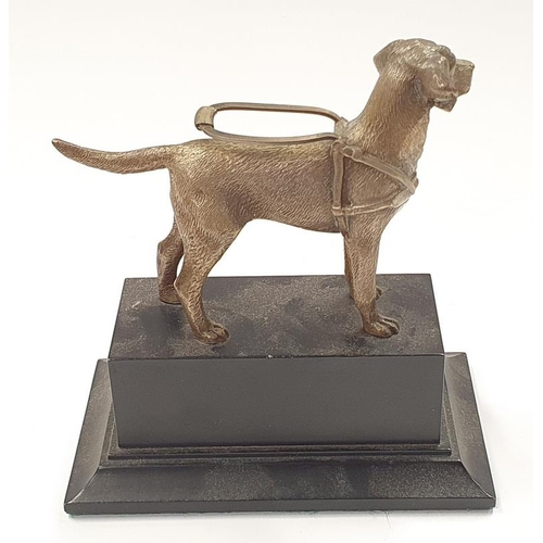 43 - A guide dogs trophy with model of a dog to top....