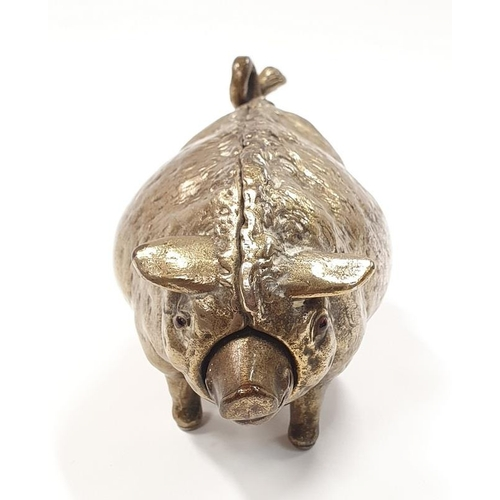 46 - A vintage solid brass wind up bell in the form of a pig....