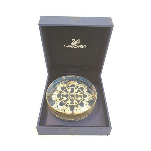 58 - A collection of paperweights to include Caithness Swarovski and Wedgwood....