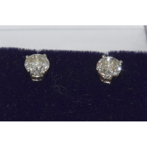 1367 - A pair of 14ct white gold diamond stud earrings of 0.9ct approx...