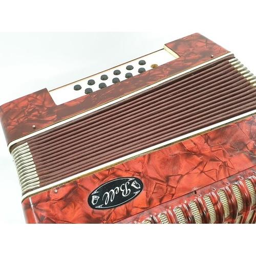 377 - A bell 12 key accordion.