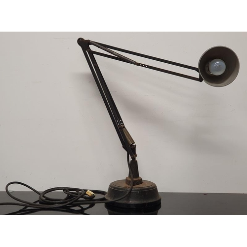 25 - An antique industrial Anglepoise style lamp with solid base....
