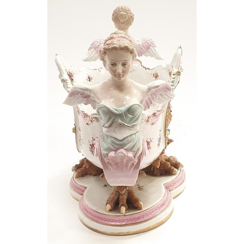 27 - A porcelain Dresden style table centrepiece with claw feet flanked on either side by two ladies....