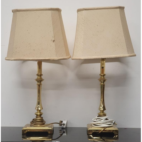 29 - A pair of modern brass table lamps with matching shades....