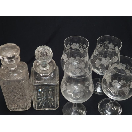 31 - A set of four drinking glasses together with two crystal glass decanters....