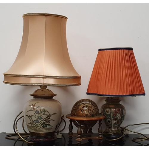 32 - Two oriental table lamps together with a miniature wooden globe....