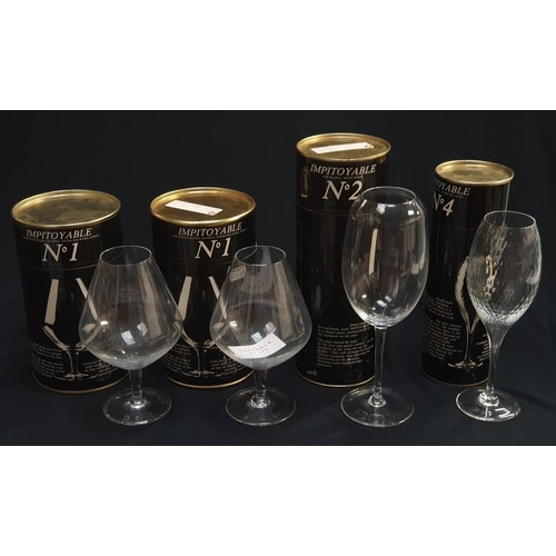 60 - A collection of four boxed glasses by Impitoyable.