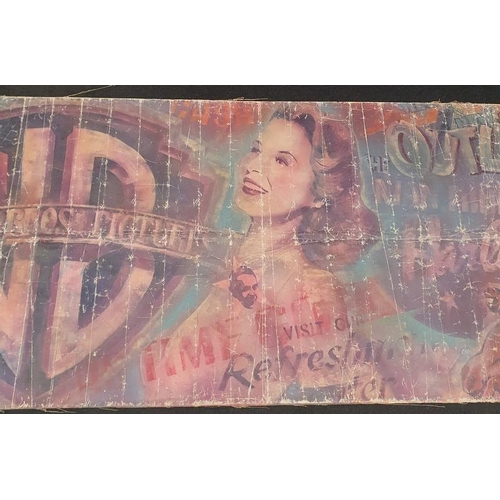 345 - Original 1940s cinema poster for Warner Brothers found behind a wall in a cinema in Barnstaple showi...