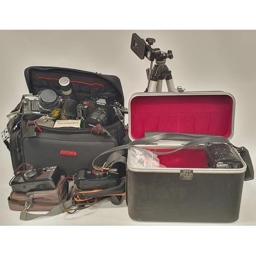 352 - Collection of camera equipments Olympus camera lenses tripods carry cases etc....