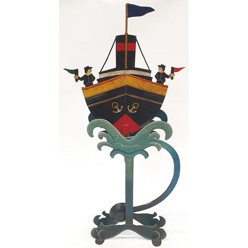 98 - Decorative metal rocking ship ornament....