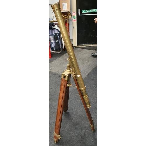 461 - A brass telescope on tripod base....
