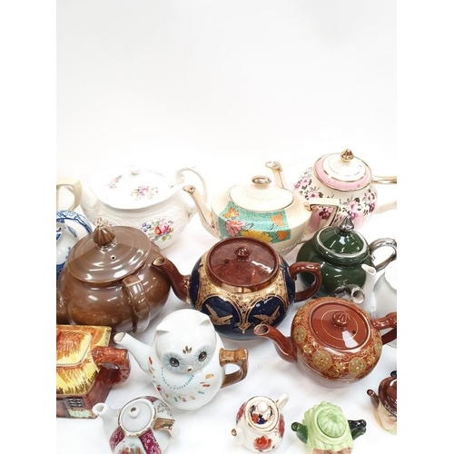 411 - Mixed collection of novelty teapots....