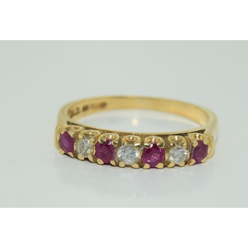 1381 - A Diamond and ruby 18ct gold ring....