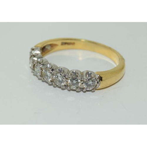 1396 - A Diamond 7 stone approx 1.2ct 18ct gold ring....