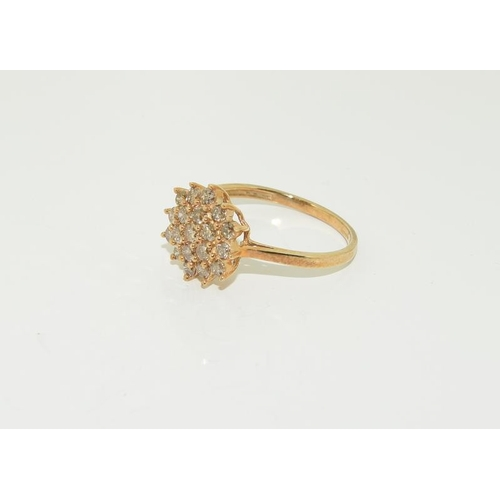 1380 - A Champagne diamond cluster 9ct gold ring....
